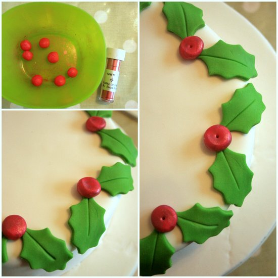 decorating cake with holly berries